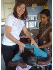 Jodie Krantz as a volunteer physiotherapist treating a patient in India