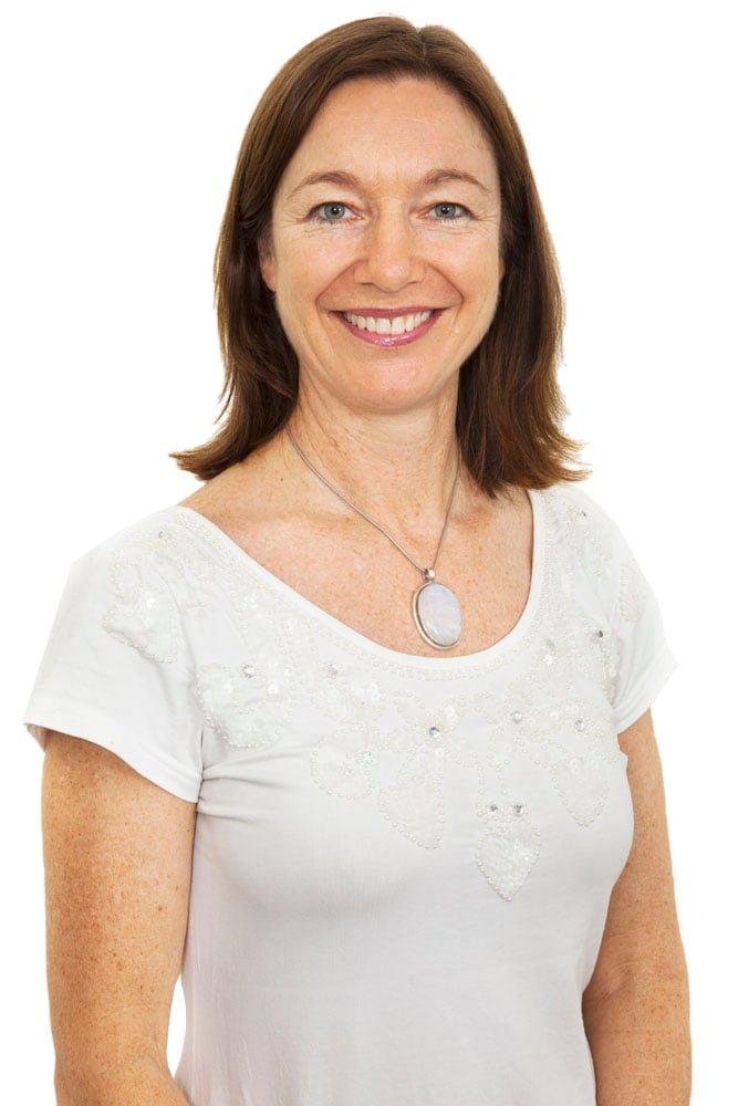 Jodie Krantz in a white t-shirt smiling bust studio shot