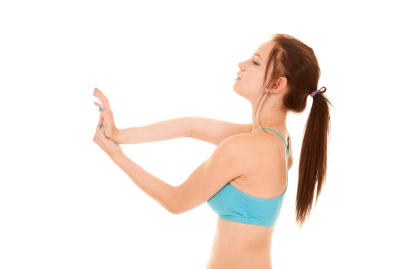 A you lady bending her elbow showing joint hypermobility