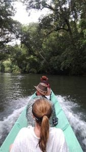 going up river in a long boat in Borneo