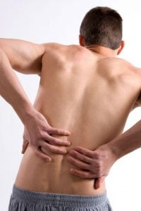 man holding his back inpain