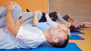 Group doing back and hip Feldenkrais exercises in fitness center