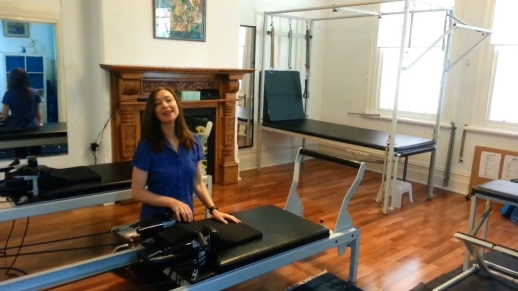 Jodie Krantz in the Free2move pilates studio giving instructions on how to use the equipment