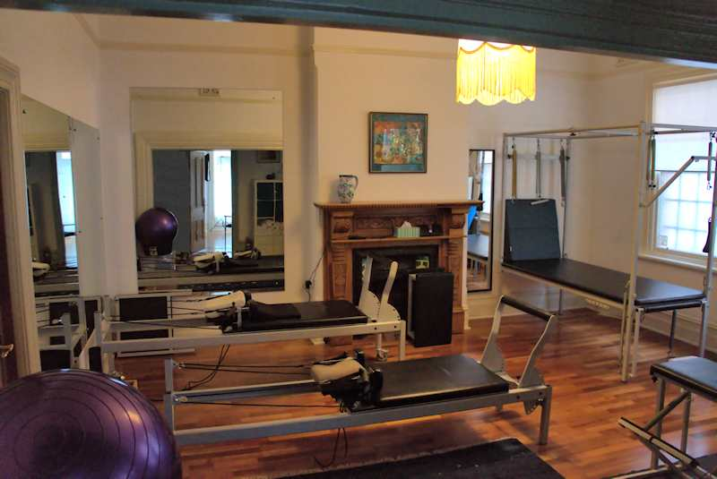 Pilates equipment, reformers, trapeze and fitballs in the Pilates studio clinic at Free2move
